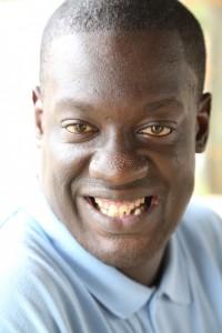 African American man facing camera, smiling