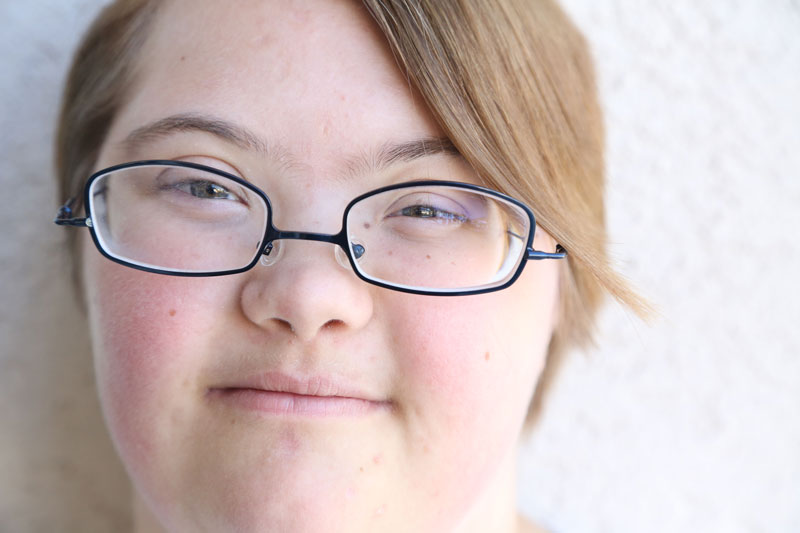 Close-up of girl's face, with glasses and short hair