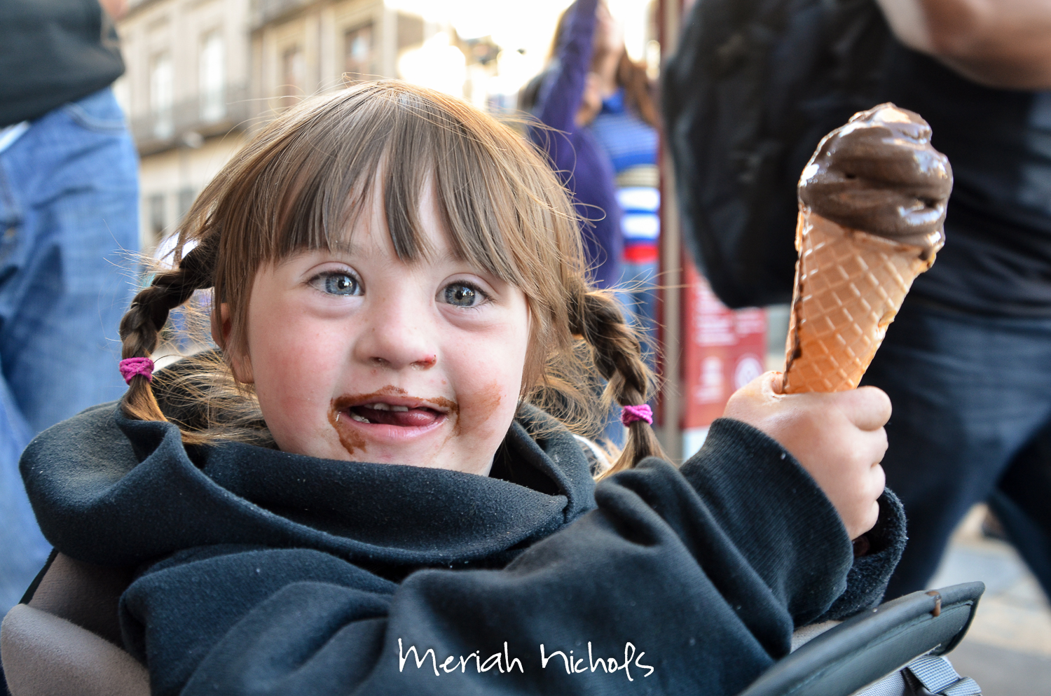 Moxie, child with Down Syndrome, holding ice cream cone