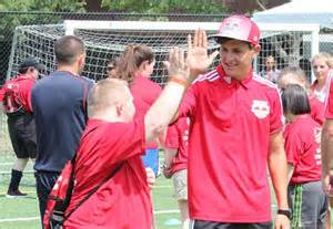 Special Olympics NY athlete and coach high-five