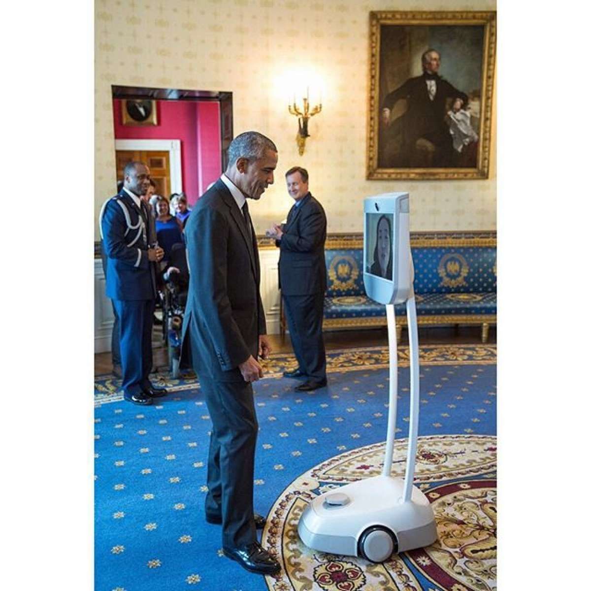 #ADA25; President Barak Obama talking to Alice Wong on mobile screen at the White House